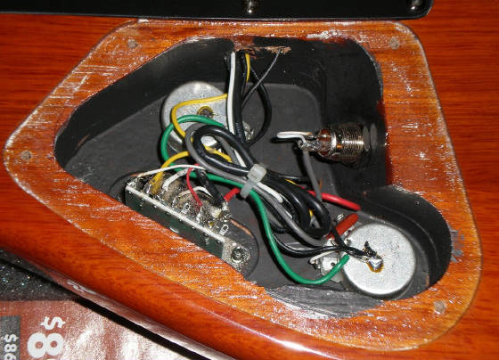 tone kicker internal guitar preamp make a note of what wire s on the output jack are connected to which terminal s they are attached to in this guitar there is a shielded wire used for the